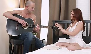 Foxy Russian girl strips and fucks her lover in bed